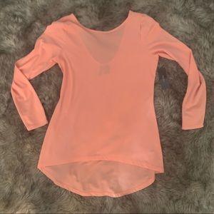 Peach blouse.